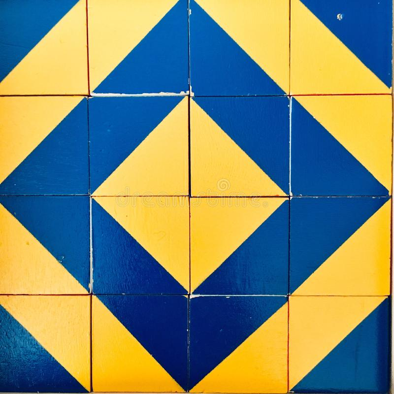 Yellow and blue triangles, mobile photo stock photos