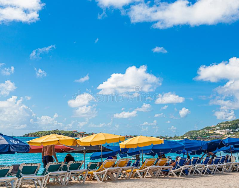 Yellow and Blue Umbrellas in Sint Maarten stock photo
