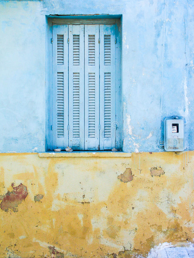 Yellow and blue wall with window stock images