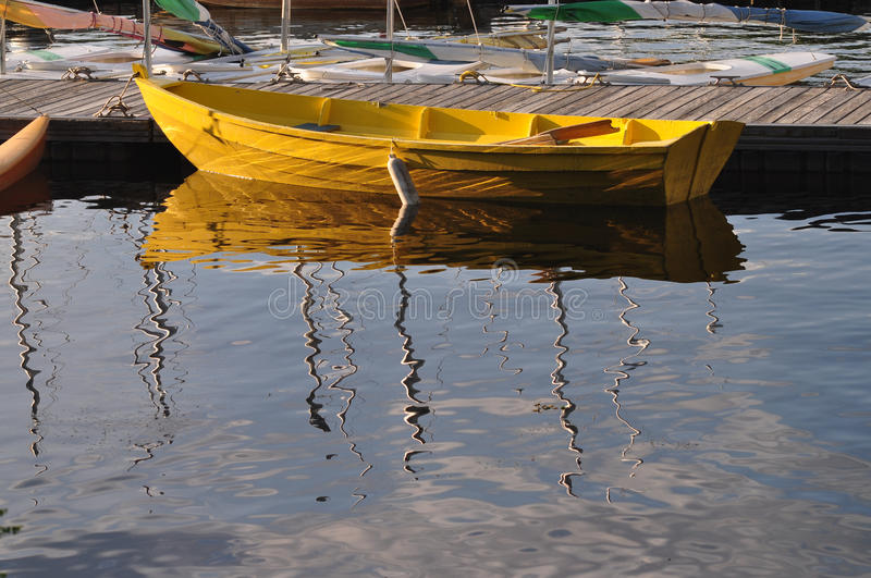 Yellow Boat. A yellow boat on a New England town's bay stock photos
