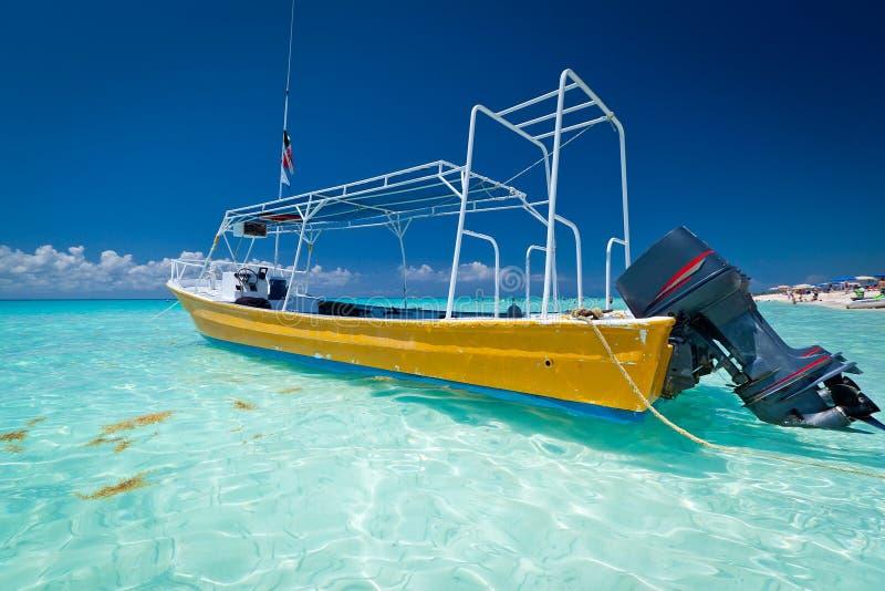 Yellow boat on the coast of Caribbean Sea stock photos
