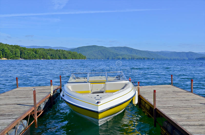 Yellow Boat at Dock on a Lake royalty free stock image