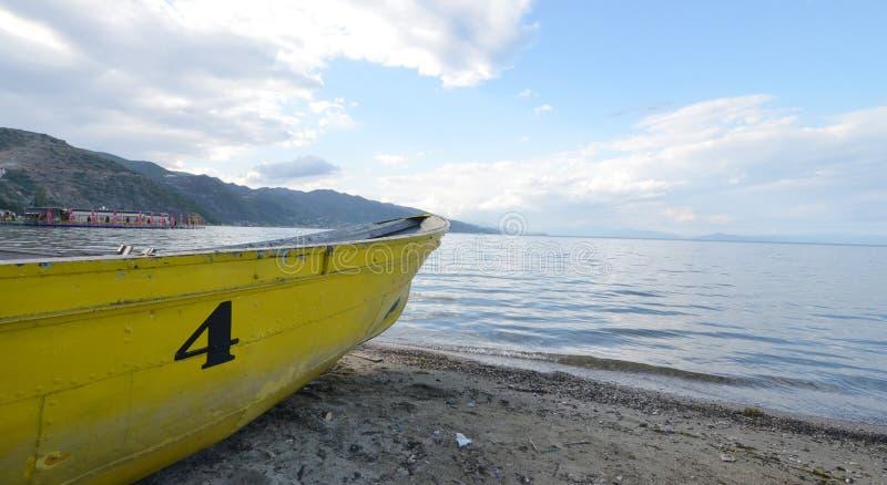 Yellow boat number four , Ohrid Lake, Albania. Picture of a Yellow boat number four , Ohrid Lake, Pogradeci , Albania stock images