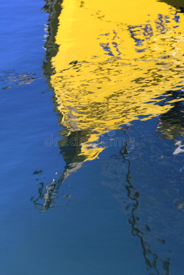 Boat Reflection in Blue Water royalty free stock photos