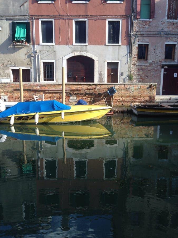 Yellow boat in venice stock photo