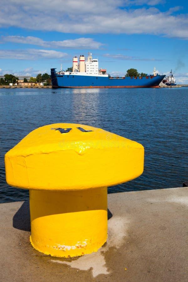 Download Yellow bollard stock photo. Image of power, quay, deck - 21374102