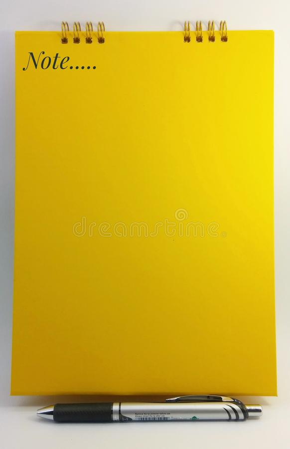 Yellow book on white background royalty free stock photo
