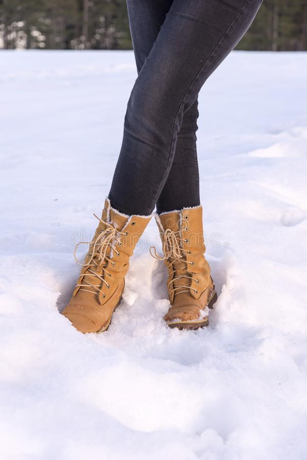 Yellow boots in the snow royalty free stock photo
