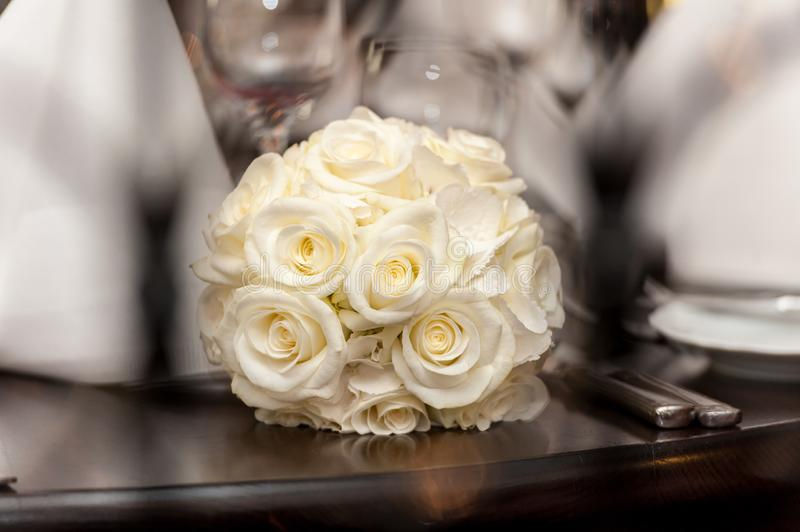 Yellow bouquet of roses on wood table royalty free stock photography