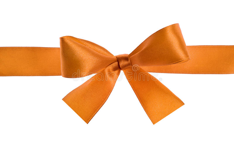 Yellow bow. Yellow gift satin ribbon bow on white background royalty free stock photo