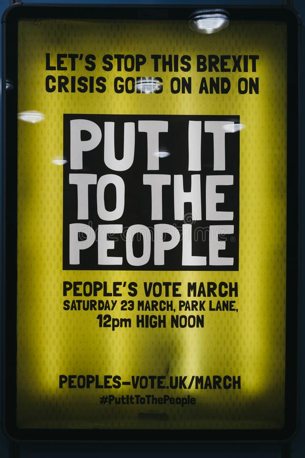 Yellow Brexit 'Put It To The People March' poster on a street in London, UK royalty free stock photography