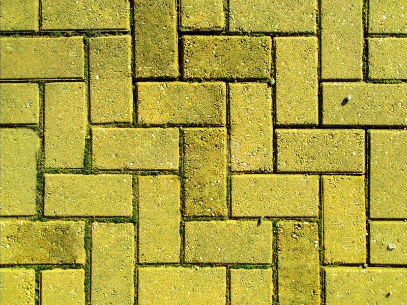 Yellow brick paving stock photos