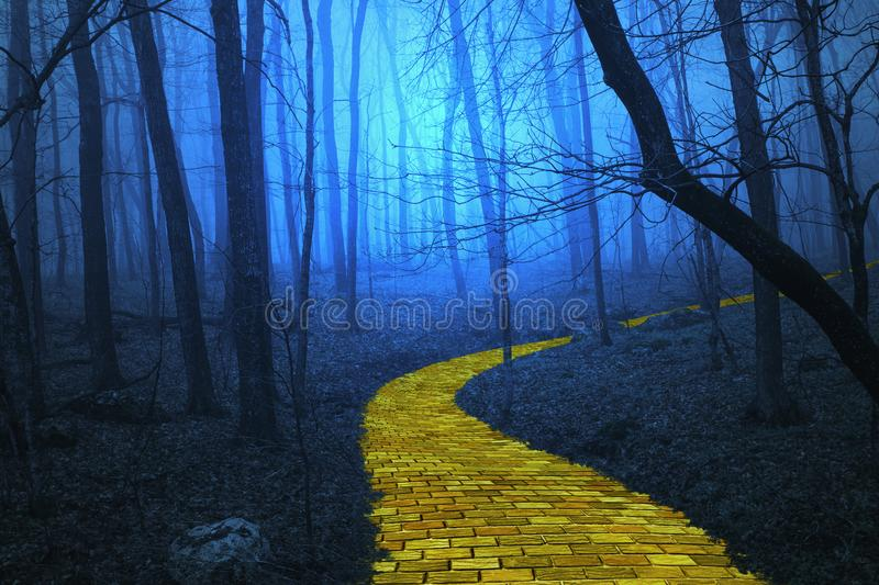Yellow Brick Road leading through a spooky forest stock illustration