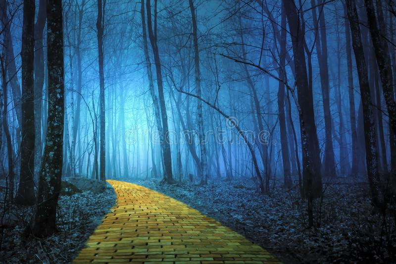 Yellow Brick Road leading through a spooky forest stock image