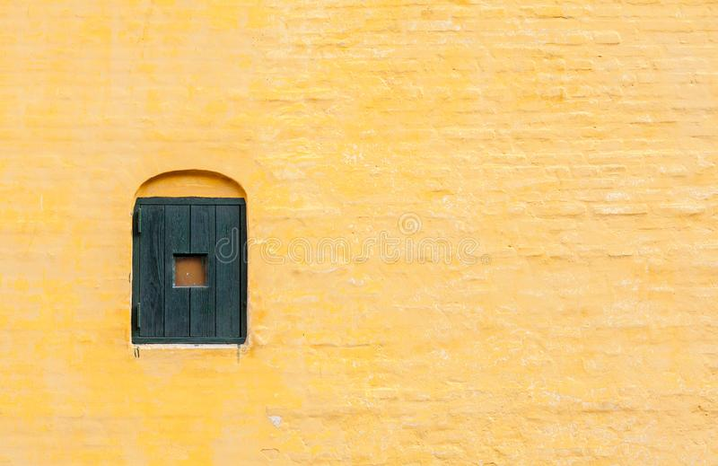 Yellow Brick Wall, Arhus, Denmark. Yellow brick wall of an old house in Arhus, Denmark stock images