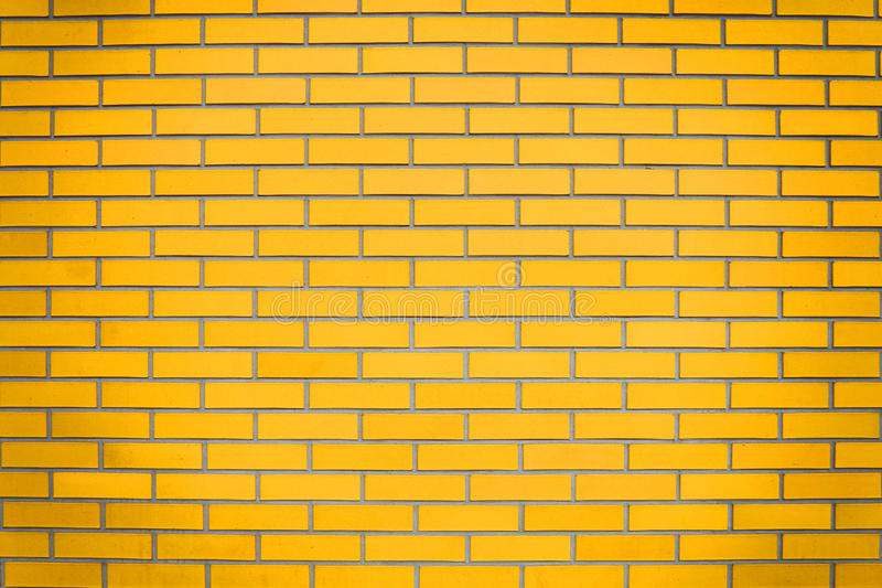 Yellow brick wall. Background idea royalty free stock images