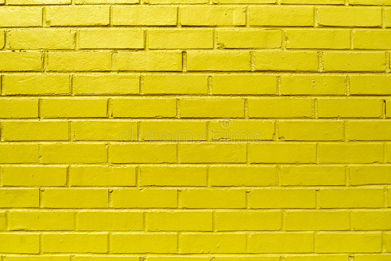 Yellow Brick Wall. Background pattern texture made from a bright yellow brick wall. Traditional masonry work stock photos