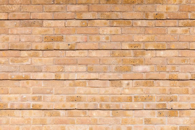 Yellow brick wall with relief lines pattern, background texture. Yellow brick wall with relief lines pattern, background photo texture royalty free stock photography