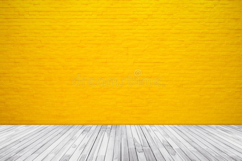 Yellow brick wall texture with wood floor background. For pattern design stock image