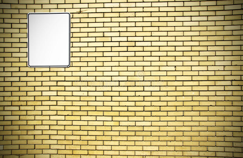 Download Yellow Brick Wall And White Sign Stock Photo - Image: 23725894