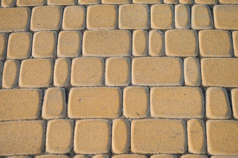 Yellow bricks. Nice floor of yellow bricks in a square stock photos