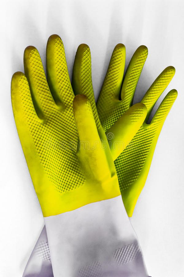 Yellow bright durable rubber gloves for cleaning isolated on white background. Closeup top view. General or regular cleanup. stock images