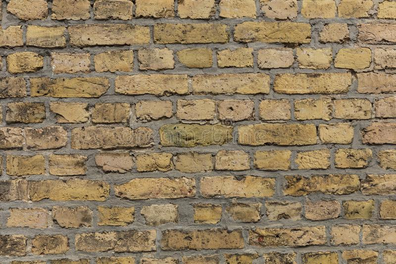 Yellow brown brick wall texture with light grey pointing. A Yellow brown brick wall texture with light grey pointing stock photography