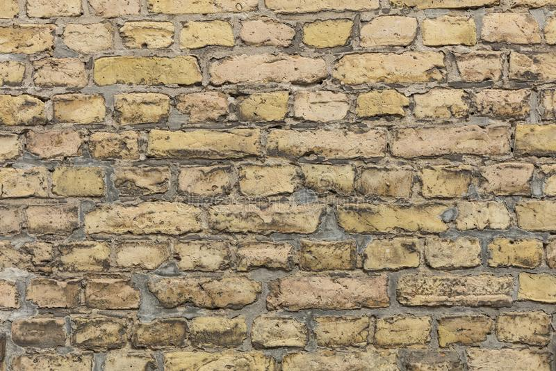 Yellow brown brick wall texture with light grey pointing. Yellow brick wall texture with light grey pointing royalty free stock images