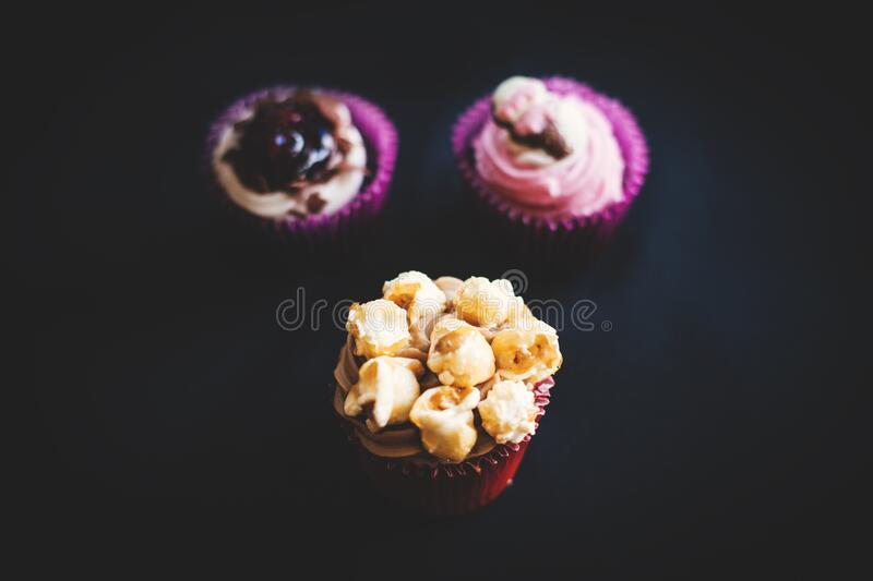 Yellow And Brown Cupcake Near Purple And White Cupcake Free Public Domain Cc0 Image