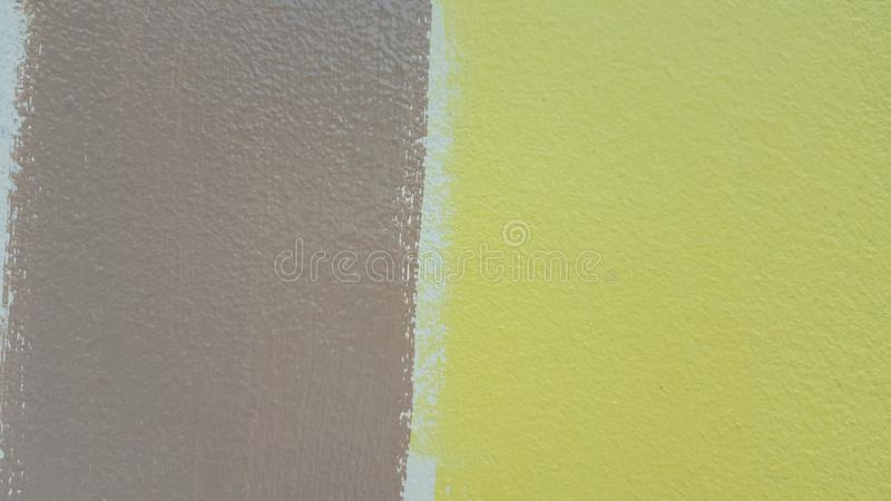 The yellow and brown paint. stock photos