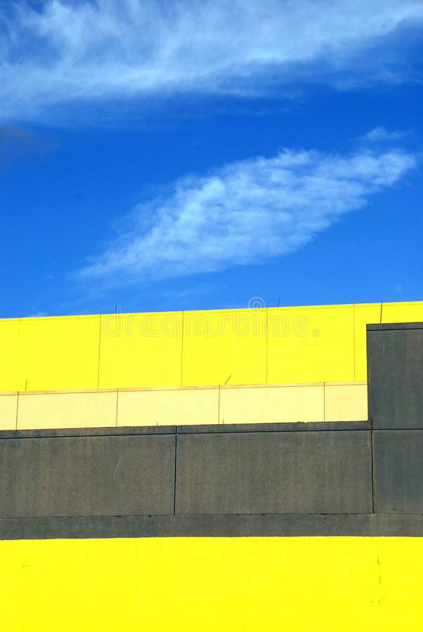 Download Yellow Building Against Blue Sky And Clouds Stock Photo - Image: 6545444