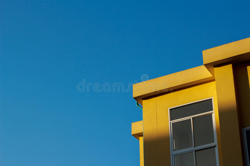 Yellow building in blue sky day. royalty free stock image