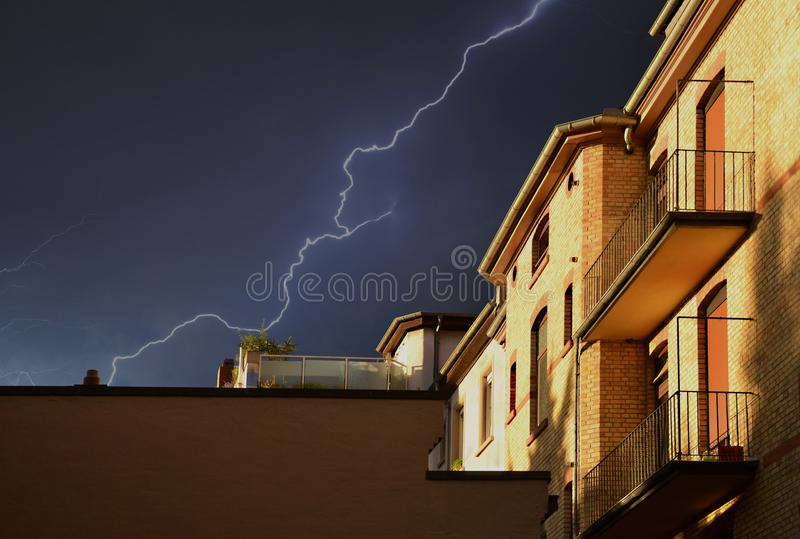 Yellow Building Under Thunderstorm in Black Sky royalty free stock photography