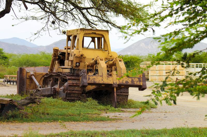 Yellow bulldozer abandoned, damaged and rusted royalty free stock images