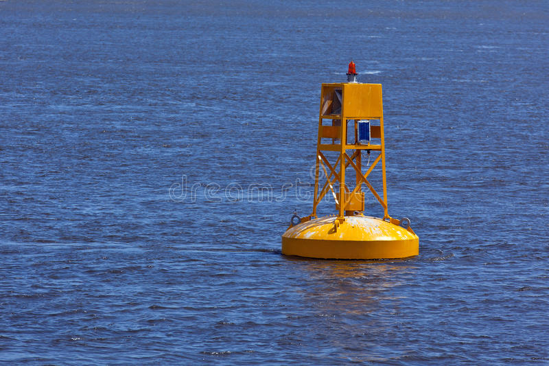 Yellow Buoy. A bright yellow buoy floating in the St. Laurence Seaway, near Quebec City stock photos