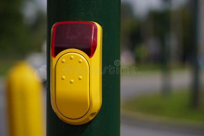 Yellow button in Braille to navigate the crosswalk. press the button to change the color of traffic lights, safety of pedestrians royalty free stock photography