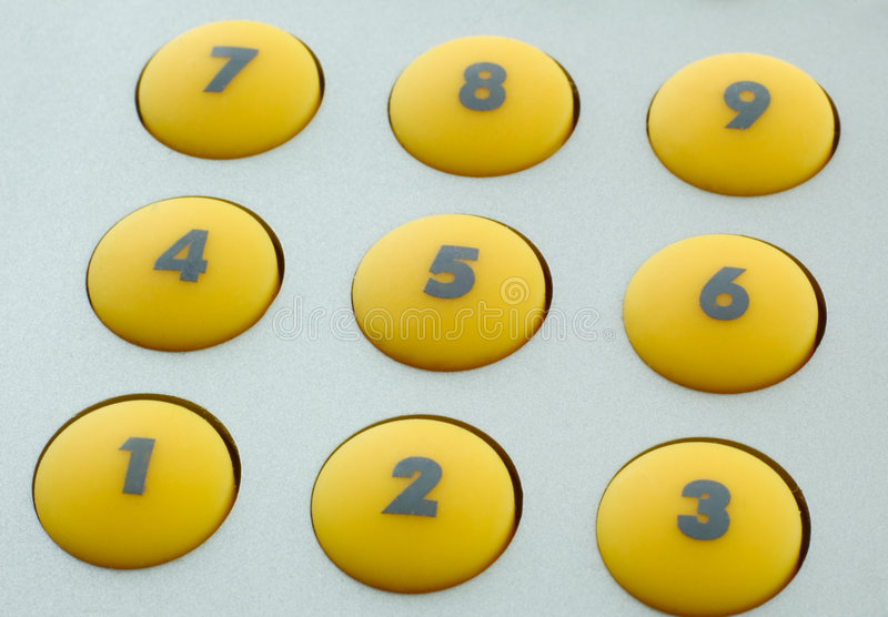 Yellow buttons. Of a calculator royalty free stock photos