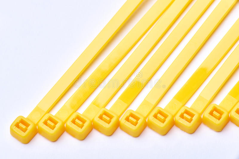 Yellow cable ties. Commercial photo on white background. stock photos