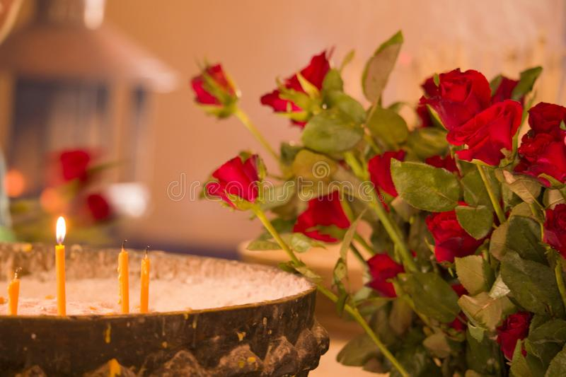 Yellow candle on the pot with sand. royalty free stock photography