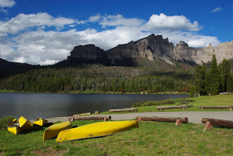 Yellow canoes and Brooks Lake, Wyoming royalty free stock images
