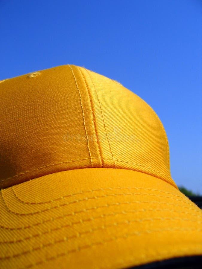 Yellow cap stock photography