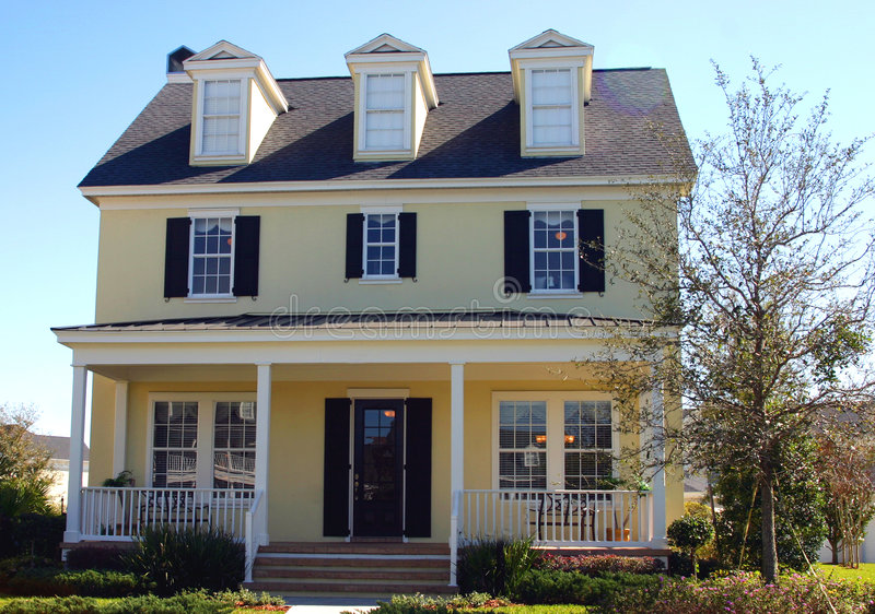 Yellow cape cod style dream home stock photos