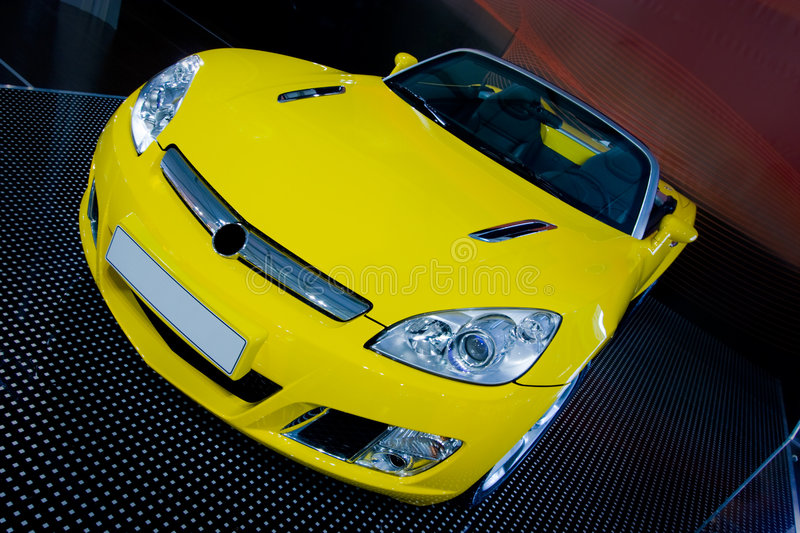 Yellow car. Yellow roadster car in the Showroom royalty free stock images