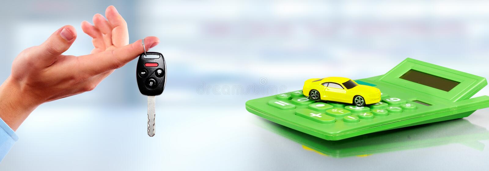Yellow car and calculator. Car and calculator. Auto dealership and rental concept background stock photography