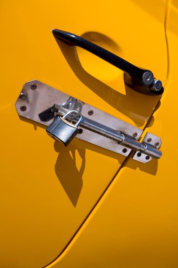 Yellow car door padlocked stock photos