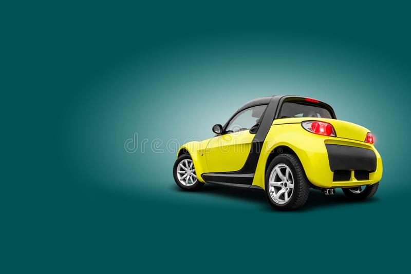 Yellow car standing back to the camera on blue background. A realistic shadow is drawn in under it. Collage. Copy space. Brand new yellow car is standing back to royalty free stock photography