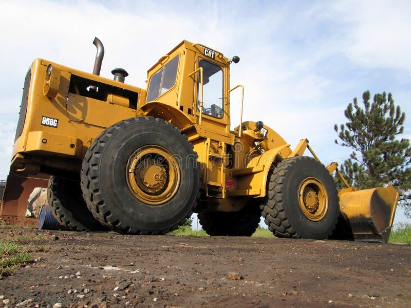 Yellow Caterpillar tractor 966g stock photos