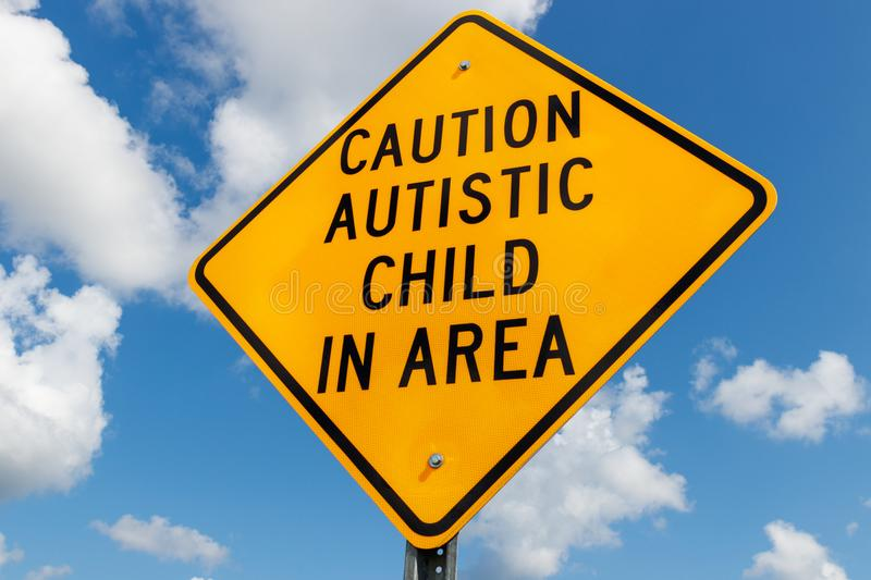 Yellow Caution Autistic Child In Area traffic sign I. Yellow Caution Autistic Child In Area traffic sign royalty free stock images