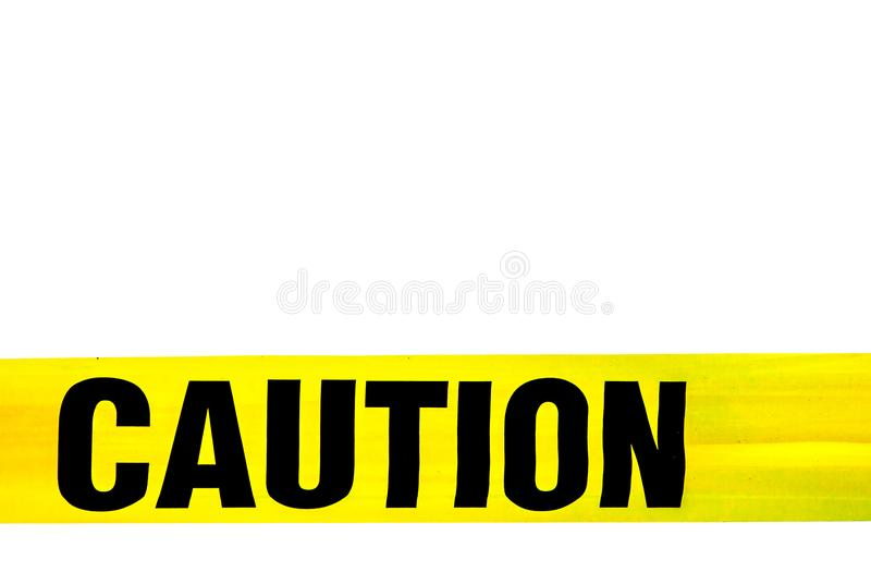 Yellow Caution sign, hazard tape to improve worksite safety isolated on white background. royalty free stock images