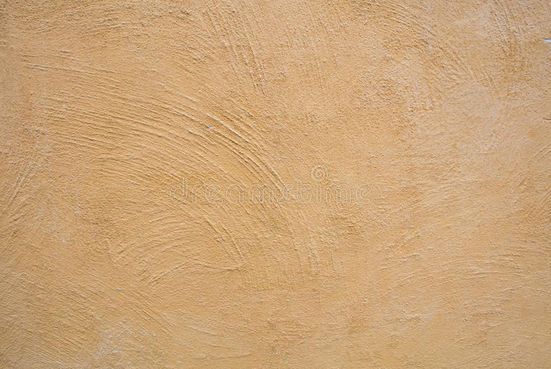 Yellow Cement Wall. Texture background stock photos